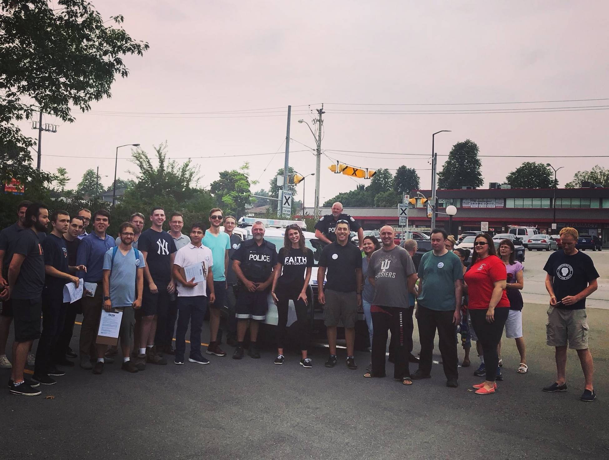 Uniformed Toronto police officers pose for campaign photograph with Faith Goldy