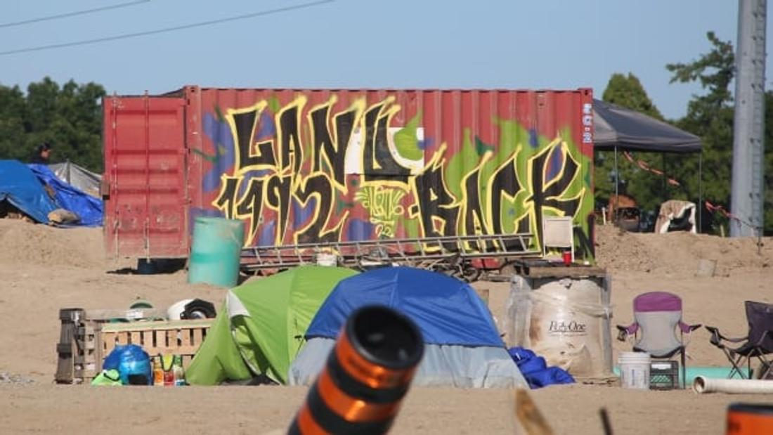 Injunction against First Nations land reclamation camp sparks skirmish with police