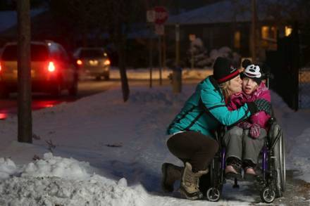 Family and wheelchair 'power through' snow — but wish they didn't have to