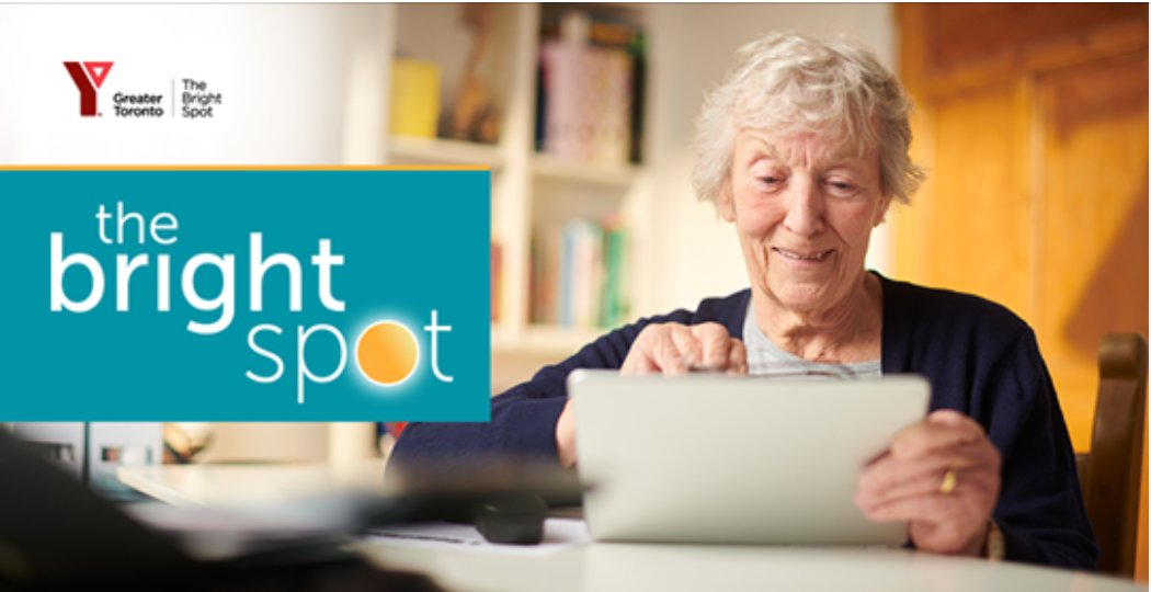 Promotional image for YWCA's Bright Spot program. Pictured: elderly person on a laptop.
