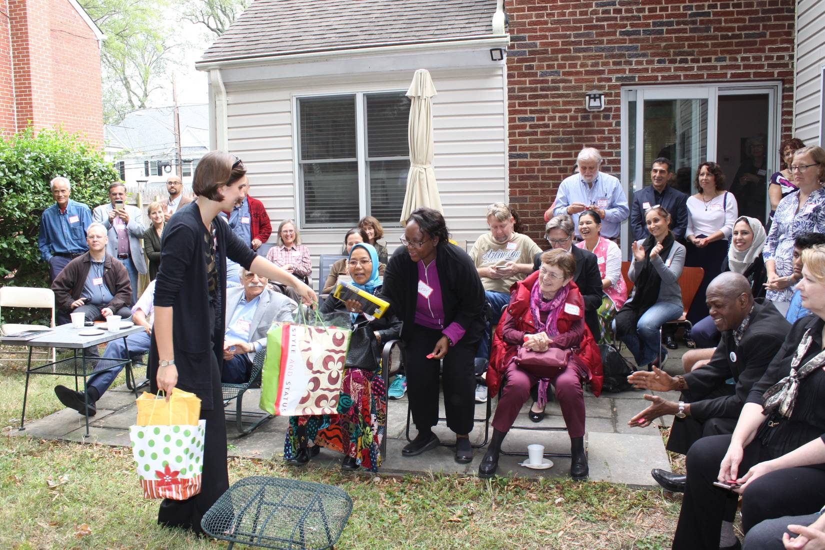 Second place raffle winner receiving prizes from Nonviolence International intern