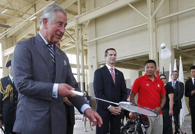 HRH Prince Charles in the machine shop in May 2012 being introduced to plans for the Pan-Am Games