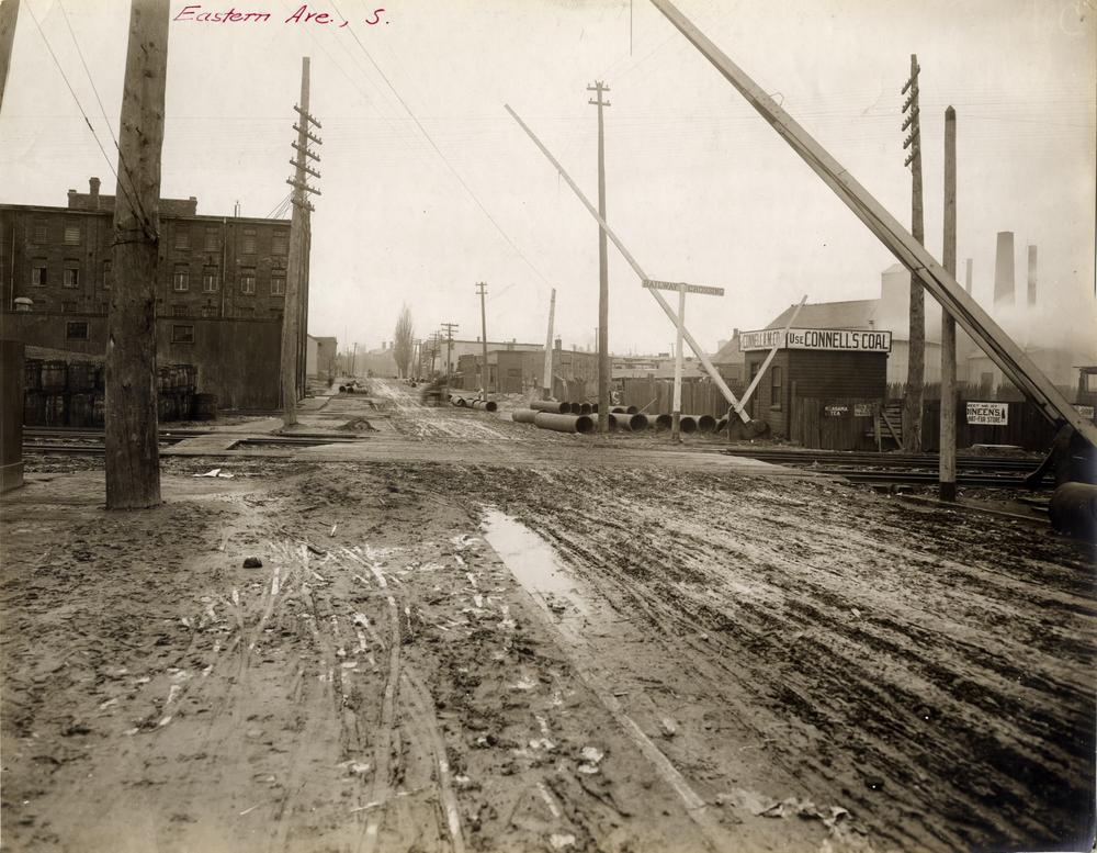 Eastern Avenue looking west across railway tracks at Cypress Street (which no longer exists). Photographer is standing near the intersection of Old Eastern Avenue and Lawren Harris Square.