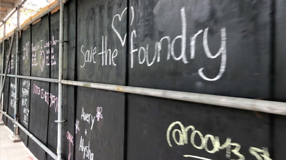 The community decorated the newly-painted hoardings using sidewalk chalk