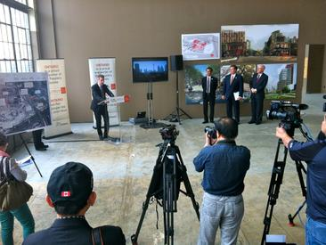 Announcement during the 2013 exhibition showing plans for the area in anticipation of the Pan Am games.