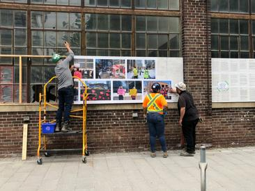 Workers removing the artworks from the south side of the Machine Shop